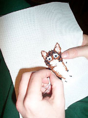 Cat in needlepoint; Size=180 pixels wide